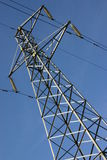 Electricity pylon. Abstract shot of electricity pylon against blue sky royalty free stock photos