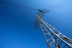 Electricity Pylon. Steel electricity pylon on bright blue sky royalty free stock images