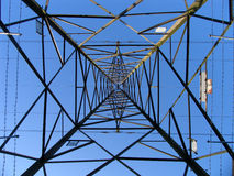 Electricity pylon. Nice geometric shot looking stright up from beneath an electricity pylon stock photography