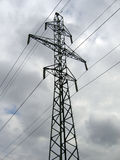 Electricity pylon. Latvian electricity pylon carrying national grid high voltage power cables Royalty Free Stock Images