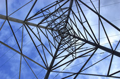 Electricity Pylon. Viewed from below with blue sky Royalty Free Stock Photos