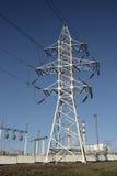 Electricity pylon. Electric pylon with power station Stock Photos