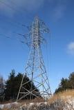 Electricity pylon. Electric power station on blue sky background Royalty Free Stock Photos
