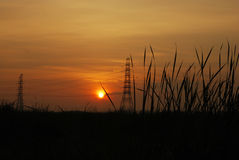Electricity pylon. And Sunset, Thailand Royalty Free Stock Photography