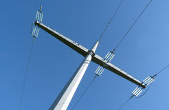 Electricity pylon. Low angle view of electricity pylon with blue sky background Royalty Free Stock Photos