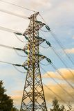 Electricity Pylon. With clouds and trees in the backround Royalty Free Stock Photo