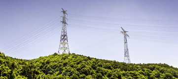 Electricity pylon. Against blue cloudy sky Stock Photos