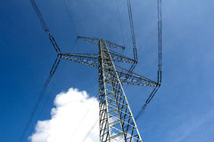 Electricity pylon against the blue sky Royalty Free Stock Photography