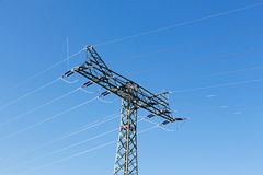 Electricity pylon against a blue sky Stock Photo