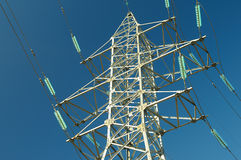 Electricity pylon against the blue sky. Royalty Free Stock Image