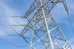 Electricity pylon against the blue sky Stock Photography