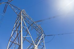 Electricity pylon against blue sky Stock Photography