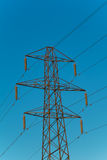 Electricity pylon against a blue sky Royalty Free Stock Image