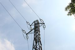 Electricity pylon against blue sky Stock Image