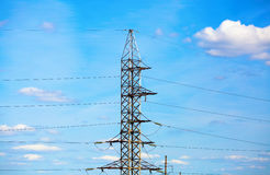 Electricity pylon against blue sky Royalty Free Stock Photography
