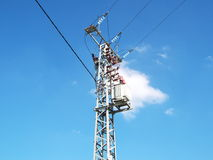 Electricity pylon. An electricity pylon against blue sky with white cloud Stock Images