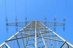 Electricity Pylon against clear blue winter sky. Electricity Pylon shot upwards against clear blue winter sky Stock Images