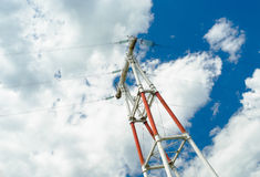 Electricity pylon against cloudy sky. Royalty Free Stock Image