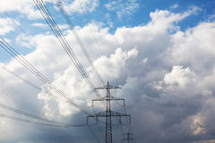 Electricity pylon against cloudy sky Royalty Free Stock Images