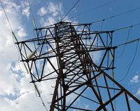 Electricity pylon against the cloudy sky background Stock Photography