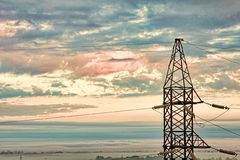 Electricity pylon against of dramatic cloudy sky. Stock Image