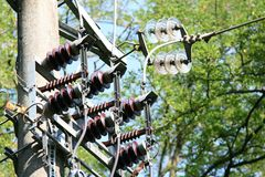 Electricity pylon against the green of nature Royalty Free Stock Photography