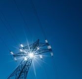 Electricity pylon against the light Royalty Free Stock Photo