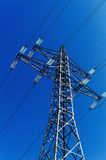 Electricity pylon against the light Stock Photography
