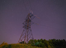 Electricity pylon against night sky Stock Images