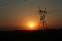 Electricity Pylon against Sunset Royalty Free Stock Photos