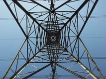 Electricity pylon from below showing geometric pattern Royalty Free Stock Image
