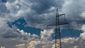 Electricity pylon. On blue sky background. (4K DSLR, Raw quality time lapse