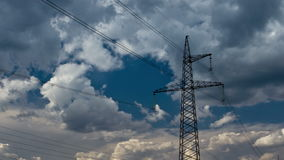 Electricity pylon. On blue sky background. 4K DSLR zooming time lapse stock footage