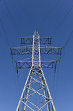 Electricity pylon blue sky Stock Image