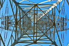 electricity pylon on bright blue sky Royalty Free Stock Photography