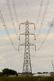 Electricity pylon and cables. Against cloudy sky Royalty Free Stock Photos