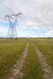 Electricity pylon with clouds Royalty Free Stock Photo