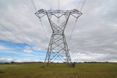 Electricity pylon with clouds Royalty Free Stock Image