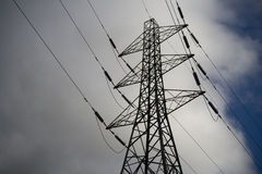 Electricity Pylon clouds and sky Royalty Free Stock Images
