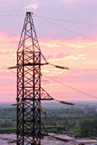 Electricity pylon on cloudy sunset sky background. Royalty Free Stock Image