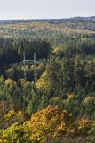 Electricity pylon in colorful forest in autumn Royalty Free Stock Images