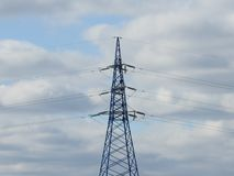 Electricity pylon, electric transmission tower, against the blue sky. Energy tower. Background cable electrical engineering environment generation high stock photo