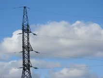 Electricity pylon, electric transmission tower, against the blue sky. Energy tower royalty free stock image