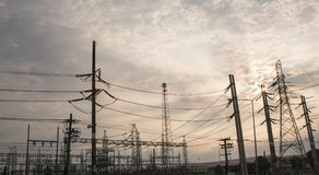 Electricity pylon,Electricity tower station with cloudy and sun over blue sky Stock Photography