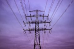 Electricity pylon in the evening Stock Photos