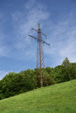 Electricity pylon in green meadow in spring Stock Photography