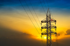 Electricity pylon. High voltage electricity pylon on sunset background Stock Images