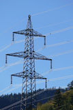 Electricity pylon, high-voltage power against blue sky Royalty Free Stock Image