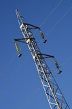 Electricity pylon. High voltage tower against clear blue sky royalty free stock photography