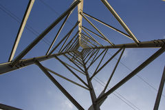 Electricity Pylon. Inside view. Electricity Pylon. Internal view. Sky and electrical cables in the background Royalty Free Stock Images